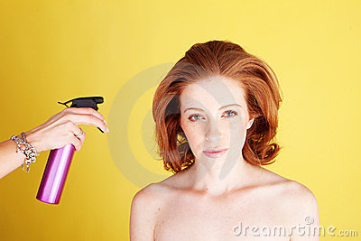 Hairstylist Applying Hair Spray