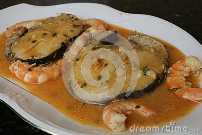 Hake fillets in prawns sauce a fish dish