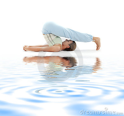 Halasana plow pose on white sand #2