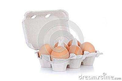 Half dozen  brown chicken eggs in box  isolated