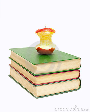 Half-eaten apple on a stack of books