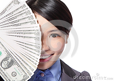 Half face of a business woman and money