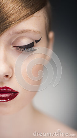 Half-face portrait of beauty woman