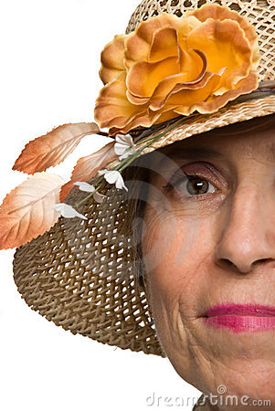 Half face senior woman with sun hat