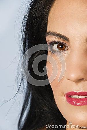 Half  face of smiling  brunette woman