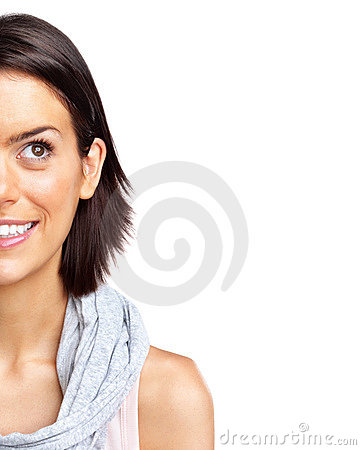 Half face of a smiling young woman looking