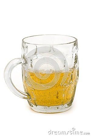 Half full glass beer tankard over white
