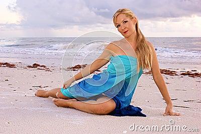 Half laying on beach