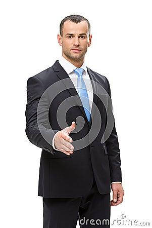 Half-length portrait of business man handshake gesturing