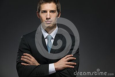 Half-length portrait of businessman with arms crossed