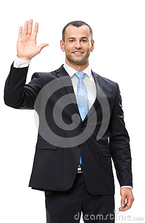 Half-length portrait of businessman waving hand
