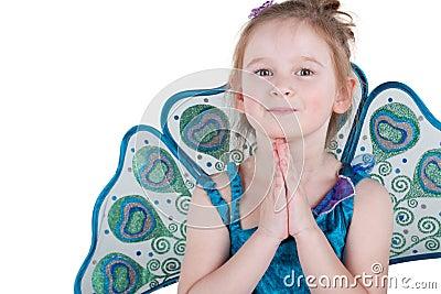Half-length portrait of little girl in fancy dress