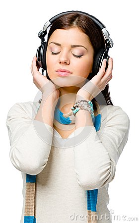 Half-length portrait of teen listening to music