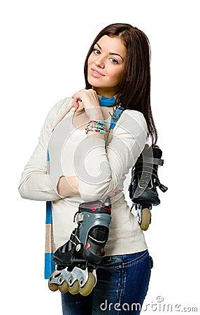 Half-length portrait of teenager holding roller skates