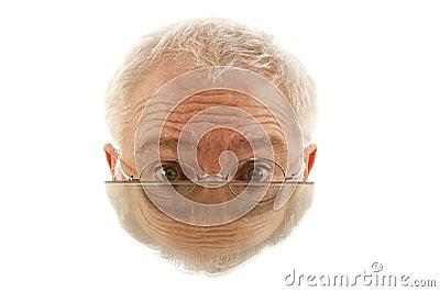 Half male face in mirror