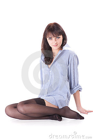 Half-naked beautiful girl in shirt and stockings.