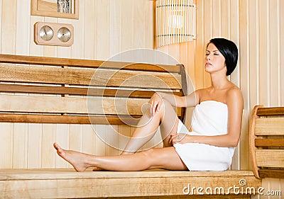 Half-naked girl relaxing in sauna