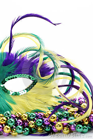 Free Half Of A Feathered Mardi Gras Mask On Beads Royalty Free Stock Photo - 7888095