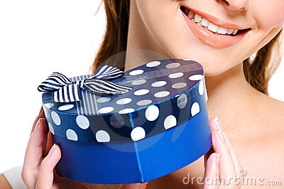 Half smiling face of  female  holding the blue box