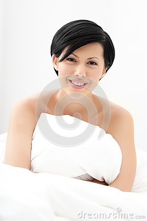 Halfnaked woman hugs the eiderdown