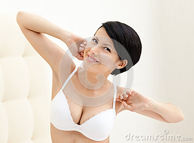 Halfnaked woman stretches herself