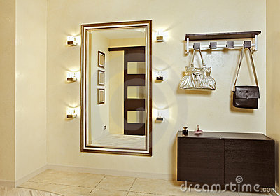 Hall in beige tones with hallstand and golden mirr