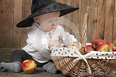 Halloween baby with basket of apples