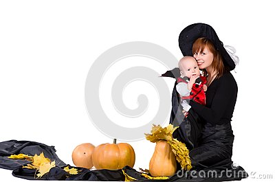 Halloween baby with mother near pumpking