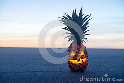Halloween on Beach. Pineapple jack o lantern