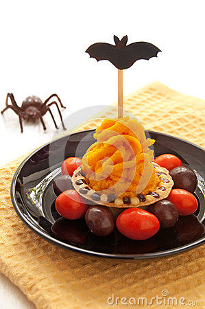 Halloween cake with orange cream