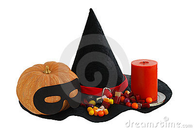 Halloween candies with candle and pumpkin