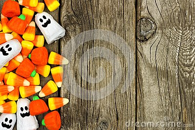 Halloween candy side border against rustic wood Stock Photo