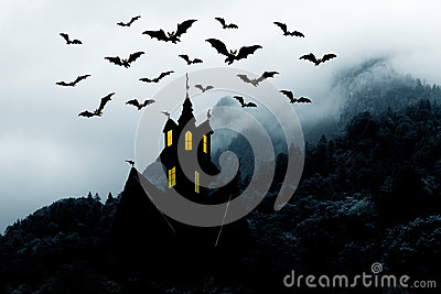 Halloween. Castle in mountains and bats