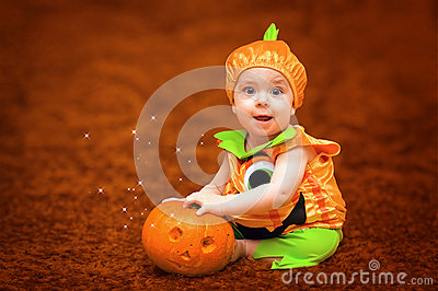 Halloween child with pumpkin