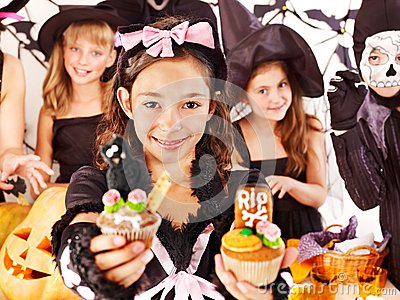 Halloween  with children holding trick or treat.