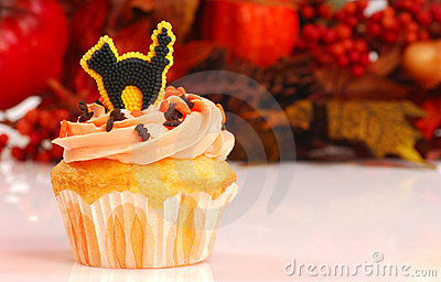 Halloween cupcake with fall foliage
