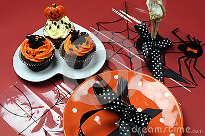 Halloween cupcakes with orange pla