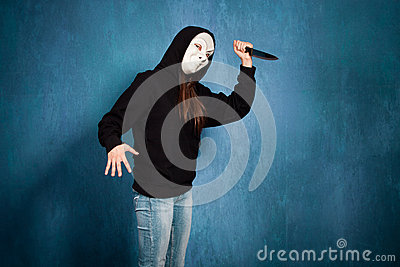Halloween girl with mask and knife