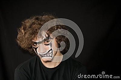halloween maquillage sur un visage du jeune homme photographie stock image 26842732. Black Bedroom Furniture Sets. Home Design Ideas