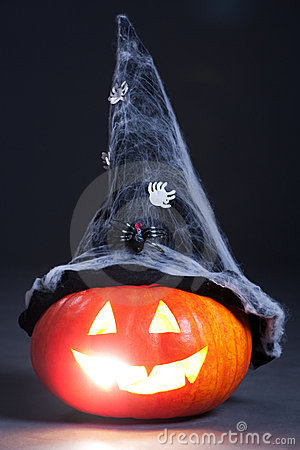 Halloween orange pumpkin with witch hat