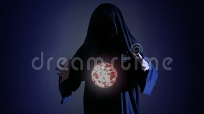 Halloween. Powerful witch or wizard with fireball in hands. Ball from fire burns stock video footage