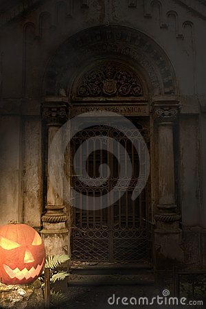 Halloween pumpkin and cemetery gate