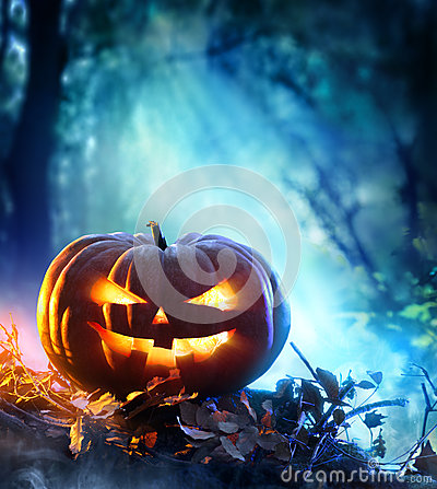 Free Halloween Pumpkin In A Spooky Forest At Night Royalty Free Stock Photography - 60246987