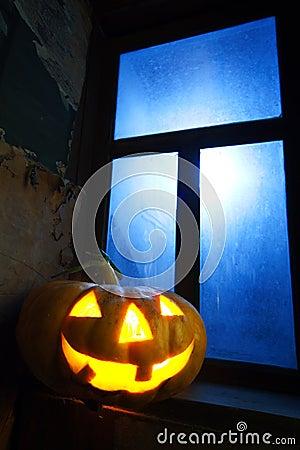 Halloween pumpkin in night on old wood room