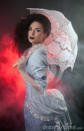 Halloween vampire woman with lace-parasol