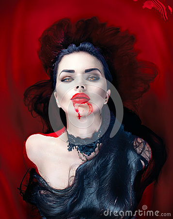 Free Halloween. Vampire Woman Lying In A Bath Full Of Blood Royalty Free Stock Photography - 78912427