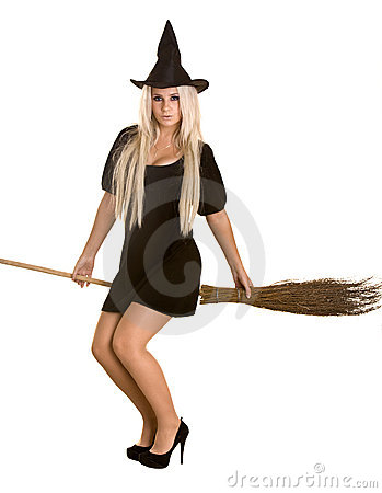 Halloween witch in black dress and hat on broom.