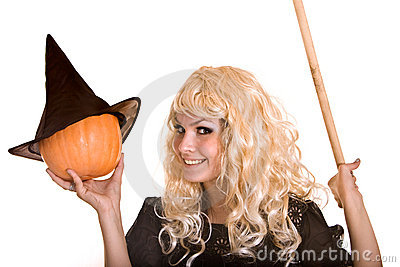 Halloween witch in black hat  with pumpkin.