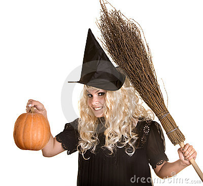 Halloween witch blond in hat and pumpkin, broom.