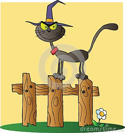 Halloween witch cat on a fence over yellow